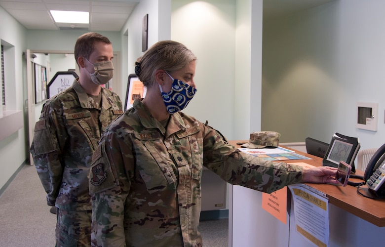 Lt. Col. Jen Wylie, 919th Special Operations Medical Squadron medical services director and Staff Sgt. Erich Miller, 919th SOMDS operational medical technician, attend a virtual morning meeting at Duke Field, Fla., April 13, 2020.