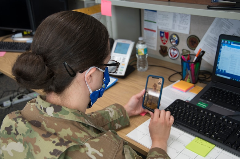 Capt. Katie Saunders, 919th Special Operations Medical Squadron, chief of public health, attends a virtual morning meeting at Duke Field, Fla., April 13, 2020.
