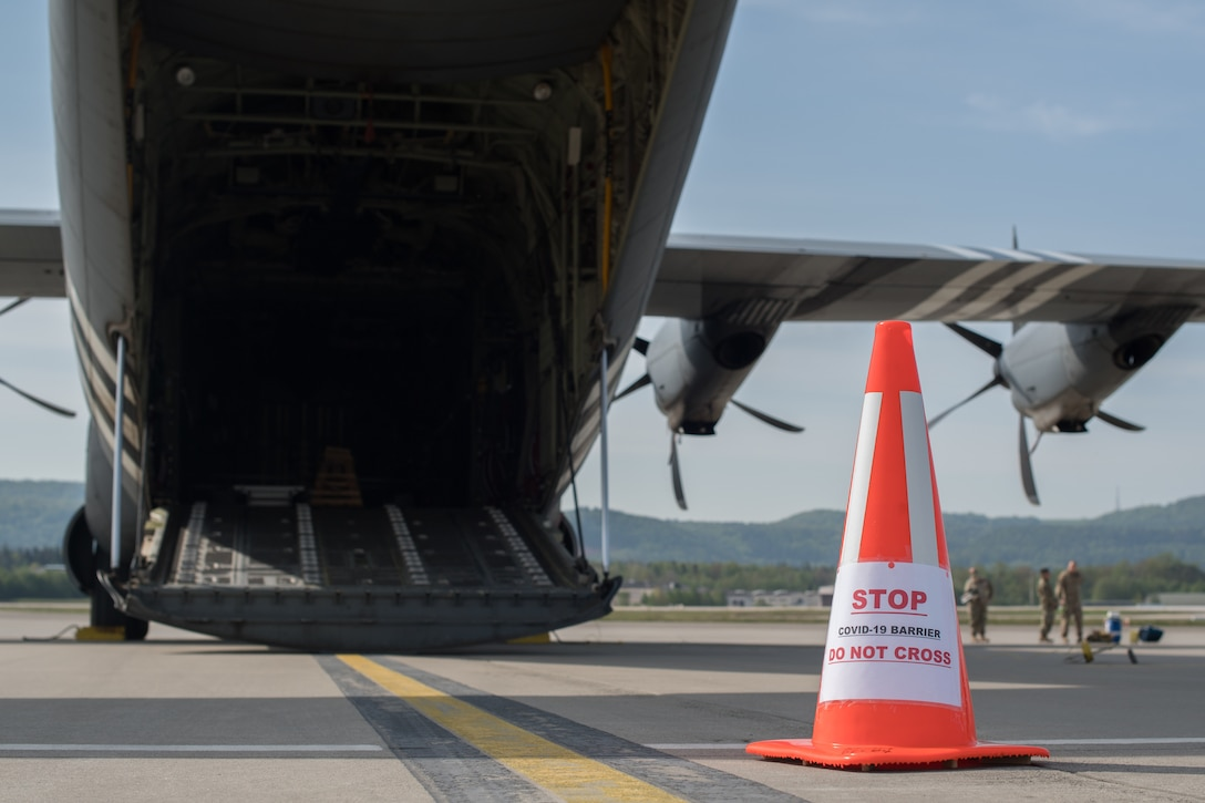 Safety cone sits beside an aircraft.