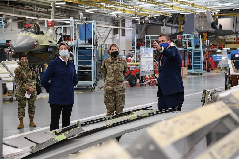 Secretary of the Air Force Barbara Barrett is briefed by Braeden Stander, 573rd Aircraft Maintenance Squadro, inside a depot maintenance hangar.