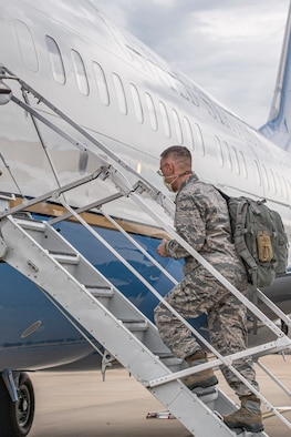 Photo of airman boarding flight.