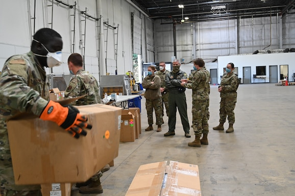 U.S. Air Force Brig. Gen. Paul Johnson, the 175th Wing commander, Maryland Air National Guard, and U.S. Air Force Col. Jori Robinson, 175th Wing vice commander, Maryland Air National Guard, visited a Strategic National Stockpile warehouse, April 16, to gain an understanding of the mission Airmen have been performing there during the state's response to the COVID-19 pandemic. Members from various units have been assisting the Maryland Office of Preparedness and Response with organizing and preparing delivery of medical PPE and life-saving ventilators to local hospitals and county health departments from their warehouse. (U.S. Air National Guard photo by Staff Sgt. Enjoli Saunders)