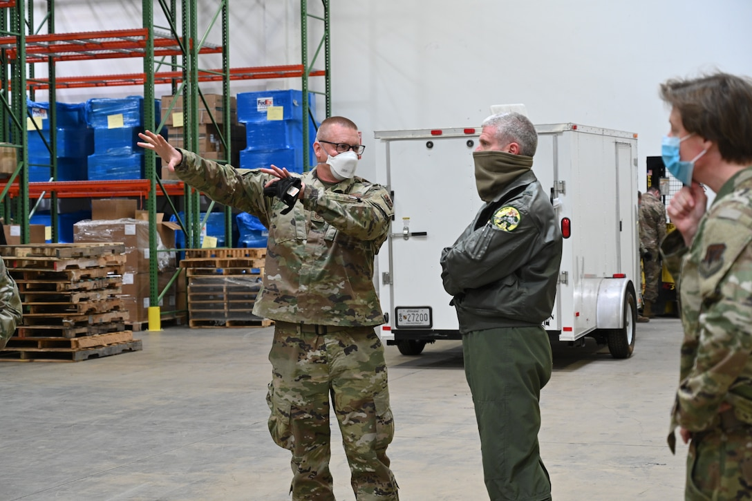 U.S. Air Force Brig. Gen. Paul Johnson, the 175th Wing commander, Maryland Air National Guard, speaks with U.S. Air Force Master Sgt. Richard Malloy, a ground transportation specialists with the 175th Logistics Readiness Squadron, Maryland Air National Guard, during a visit to a Strategic National Stockpile warehouse, April 16, to gain an understanding of the mission Airmen have been performing there during the state's response to the COVID-19 pandemic. Members from various units have been assisting the Maryland Office of Preparedness and Response with organizing and preparing delivery of medical PPE and life-saving ventilators to local hospitals and county health departments from their warehouse. (U.S. Air National Guard photo by Staff Sgt. Enjoli Saunders)