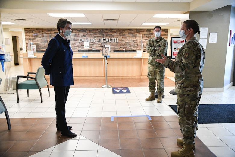 Secretary of the Air Force Barbara Barrett listens to Lt. Col. Jennifer Hardos, 75th Medical Group, in the lobby of the medical clinic.
