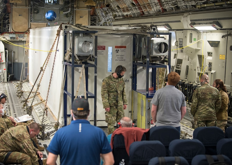 In-flight testing is conducted to certify a Negatively Pressurized Conex prototype on a C-17 Globemaster III, April 30, 2020. The NPC is designed to transport individuals with the COVID-19 virus and other highly infectious diseases, all while preventing the aircrew and medical professionals onboard from being exposed. (U.S. Air Force photo by Staff Sgt. Chris Drzazgowski)