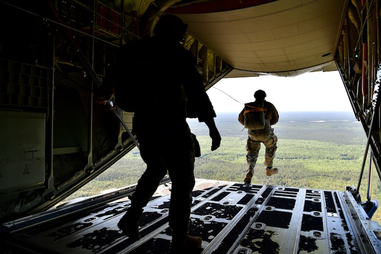 Master Sgt. Ed Dawejko and U.S. Air Force Tech. Sgt. Nader Maghribi, 19th Operations Support Squadron Survival Evasion Resistance and Escape specialists, perform a static-line jump over Sontay drop zone, Florida.