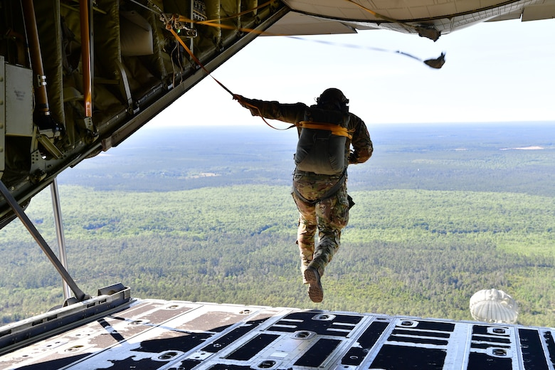 Master Sgt. Ed Dawejko, 19th Operations Support Squadron Survival Evasion Resistance and Escape specialist, performs a static-line jump over Sontay drop zone, Florida.