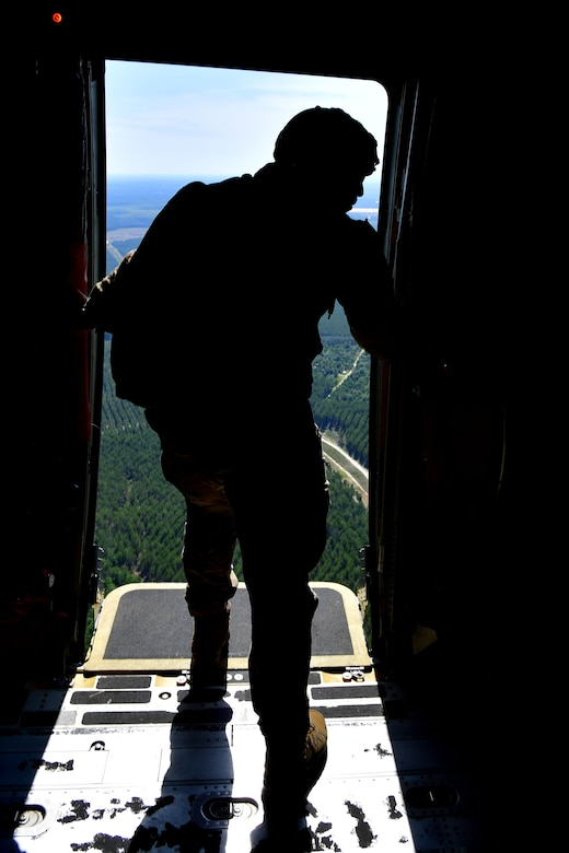 U.S. Air Force Tech. Sgt. Nader Maghribi, 19th Operations Support Squadron Survival Evasion Resistance and Escape specialist, completes the jumpmaster pre-check prior to personnel from the Air Force Special Operations Command special tactics training squadron perform static-line jumps over Sontay drop zone, Florida.