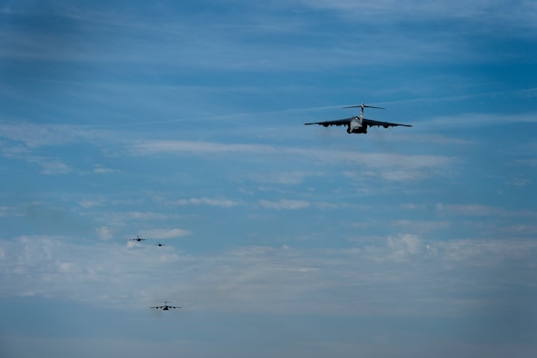 U.S. Air Force C-17 Globemaster IIIs assigned to the 58th Airlift Squadron, take off from Altus Air Force Base, Oklahoma, in support of essential personnel fighting COVID-19, May 1, 2020.