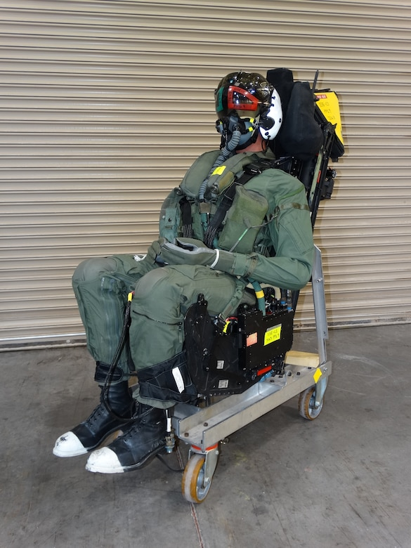 A manikin is integrated with the ejection seat for an F-35 canopy test March 26, 2020, at Holloman Air Force Base, N.M. The build-up, completed by the 846th Test Squadron of the 704th Test Group, Arnold Engineering Development Complex, involved installing the ejection seat explosives and dressing of the manikin prior to installation in the aircraft forebody test apparatus. (U.S. Air Force photo by Lt. Col. Gregory Barber)