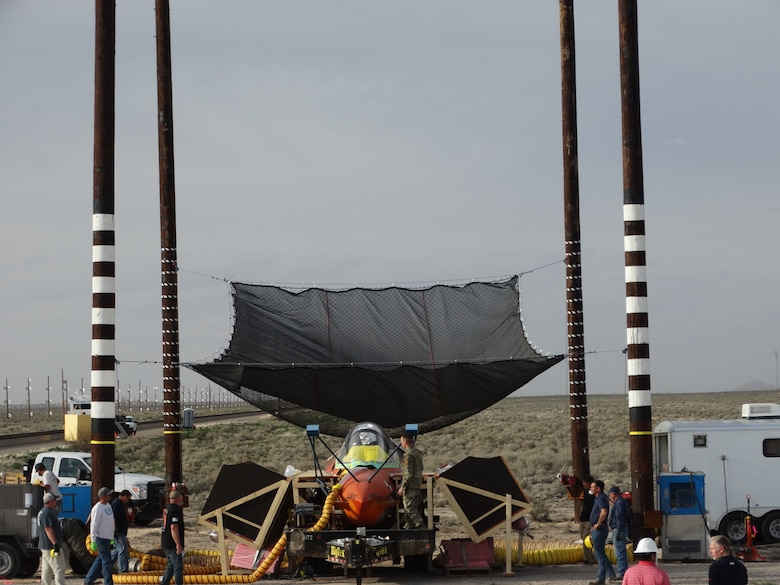 """The test team from the 846th Test Squadron, the Joint Strike Fighter and the manufacturers perform final checkouts and configurations prior to a """"worst-case scenario"""" F-35 static canopy test in which the ejection seat must push through the canopy at 0 knots, with an overheated canopy on March 27, 2020, at Holloman Air Force Base, N.M. (U.S. Air Force photo by Timothy Gros)"""
