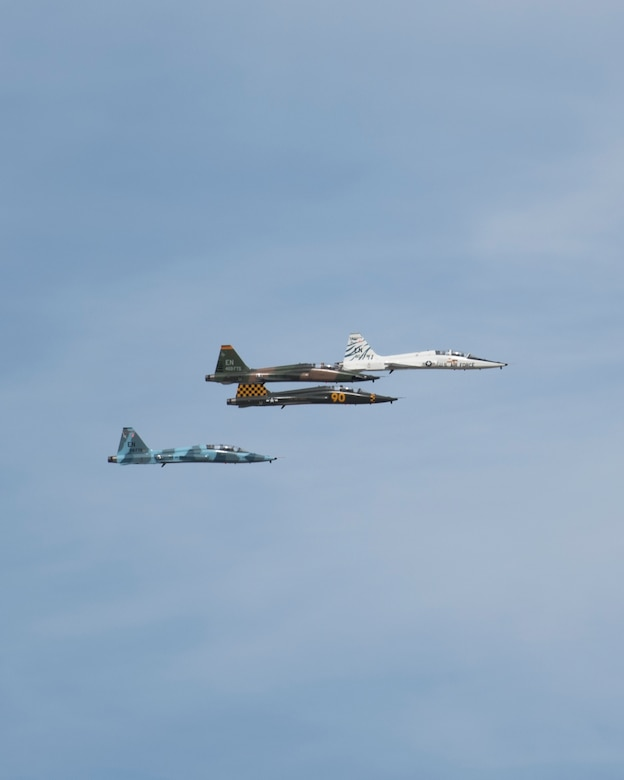 Four T-38 Talon aircraft participate in the Spirit of Texoma flyover on May 1, 2020. The flyover was a way for Sheppard Air Force Base, Texas, to show gratitude towards the COVID-19 frontline healthcare workers in the local community. The flyover consisted of a 4-ship T-38 Talon formation and a 4-ship T-6 Texan II formation, with a T-38 and T-6 chase plane behind them for photo and video. (U. S. Air Force photo by Senior Airman Pedro Tenorio)