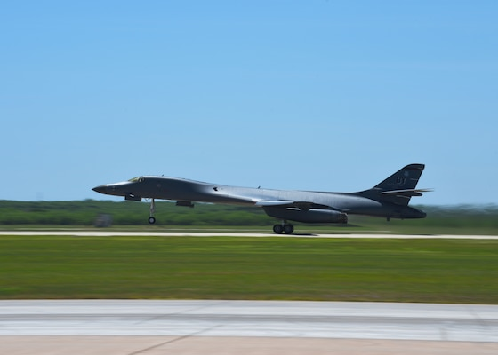 A B-1B from the 9th Bomb Squadron Lancer takes off for a Bomber Task Force deployment at Dyess Air Force Base, Texas, April 30, 2020. Four B-1Bs deployed to Andersen Air Force Base, Guam, As part of U.S. Strategic Command's support to the National Defense Strategy objectives of strategic predictability and operational unpredictability by using a mix of different aircraft to and from various dispersed U.S. bases and other departure and arrival points, to include Guam. (U.S. Air Force photo by Senior Airman Mercedes Porter)