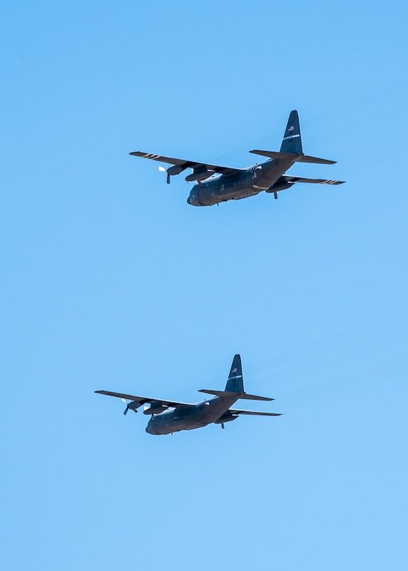 Two Kentucky Air National Guard C-130 Hercules aircraft from the 123rd Airlift Wing fly over Louisville, Ky., May 1, 2020, as part of Operation American Resolve, a nationwide salute to all those supporting COVID-19 response efforts. The operation is intended to lift morale during a time of severe health and economic impacts that have resulted from COVID-19. (U.S. Air National Guard photo by Senior Airman Chloe Ochs)