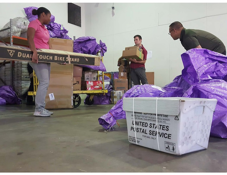 Airmen assigned to the Pacific Air Forces Air Postal Squadron prepare mail for delivery at the Sydney Aerial Mail Terminal in Sydney, Australia, April 28, 2020. The Pacific Air Forces Air Postal Squadron partnered with the U.S. Army, U.S. Air Force Air Mobility Command as well as the U.S. Navy to deliver thousands of pounds of mail to Republic of Korea, Japan, and Australia. (Courtesy Photo)