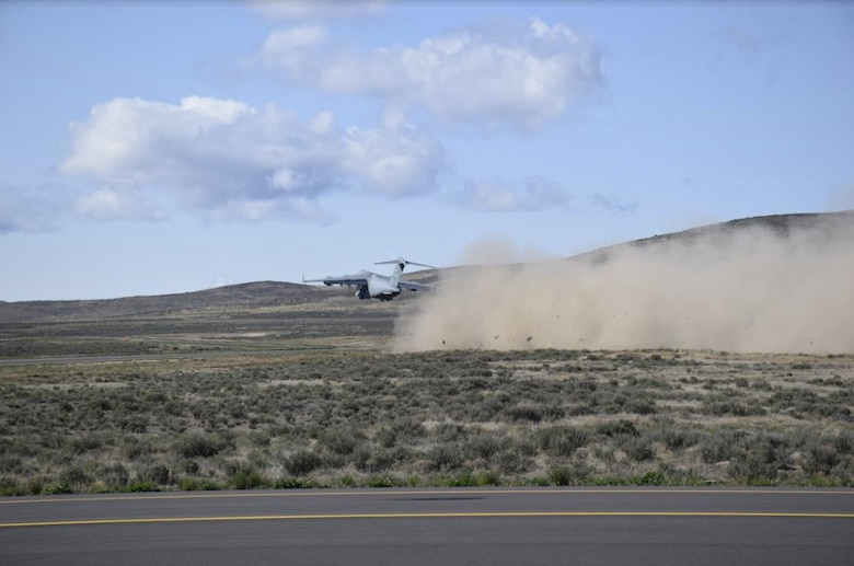 A C-17 Globemaster III takes off from the Mettie Airstrip at Yakima Training Center, Wash., April 23, 2020. Instructors and students of the C-17 Weapons Instructor Course (WIC) taught out of the 57th Weapons Squadron on Joint Base Lewis-McChord, Wash. conducted an aeromedical evacuation exercise as part of the scenario based training phase of the WIC. (Courtesy Photo)