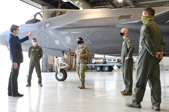 Secretary of the Air Force Barbara Barrett speaks with 388th and 419th Fighter Wings leadership in front of an F-35A Lightning II aircraft.