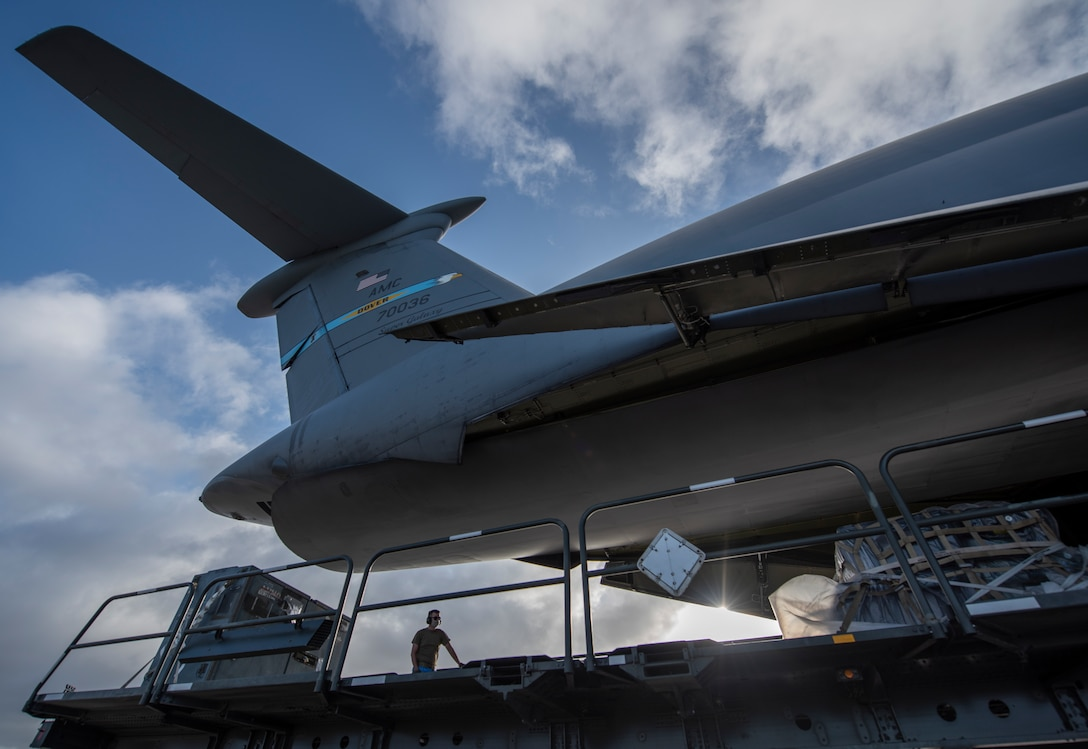 An Airman from the 36th Logistics Readiness Squadron unloads cargo from a C-5M Super Galaxy at Andersen Air Force Base, Guam, April 29, 2020. The C-5 delivered cargo for the 9th Expeditionary Bomb Squadron Bomber Task Force deployment. The BTF is deployed to Andersen AFB to support Pacific Air Forces' training efforts with allies, partners and joint forces; and strategic deterrence missions to reinforce the rules-based order in the Indo-Pacific region. (U.S. Air Force photo by Senior Airman River Bruce)