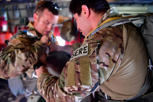 Tech. Sgt. Nader Maghribi, 19th Operations Support Squadron Survival Evasion Resistance and Escape specialist, performs an equipment check on U.S. Air Force Master Sgt. Ed Dawejko, 19th OSS SERE specialist, in Florida.