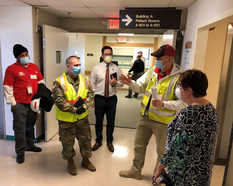 USACE Philadelphia District Deputy Commander LTC Brian Corbin (center) tours the recently completed St. Francis Medical Center Alternate Care Facility in Trenton, N.J. with USACE Engineer Derek Burleigh (second from right); Jamaal Edwards (left) of the USACE Philadelphia District Contracting Division and NJ Department of Health and hospital staff. The mission was part of a federal, state, and local response to the COVID-19 Pandemic.