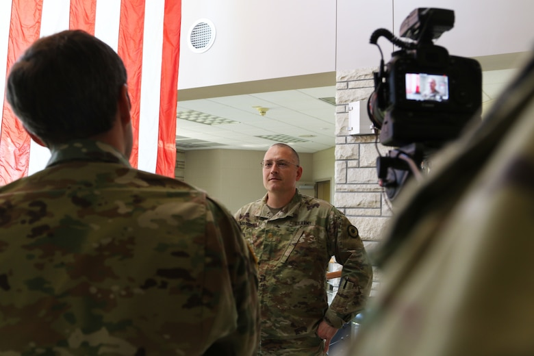 Maj. James Marshall, health services human resource officer, Kansas Medical Detachment, prepares for an interview with guard media to discuss the collaborative effort of the Joint Task Force in Topeka, Kansas, April 30, 2020. The Kansas National Guard receives mission assignments from the Kansas Division of Emergency Management using an established response process.  Joint Task Force Ready Guardian provides command and control, mission execution and personnel management in conjunction with the Joint Operations Center as part of the COVID-19 response.