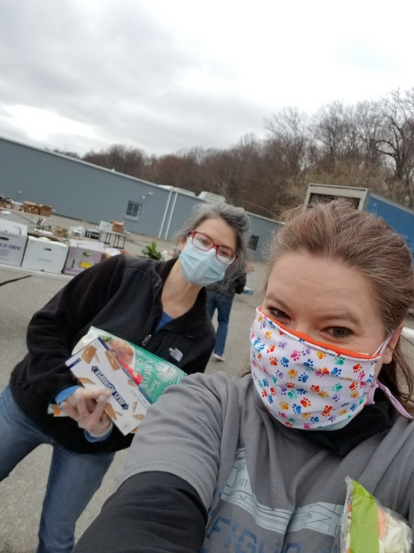 Lisa Potito, wellness team coordinator, right, and Mary Keeler, sexual assault response coordinator, left, help distribute food at a local nonprofit organization farmers market free for the military, April 4, 2020. (Courtesy photo)