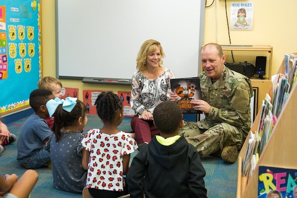 Brig. Gen. Doug Schiess, 45th Space Wing commander, and Mrs. Debbie Schiess, Key Spouse mentor, read to children to support literacy in January of 2020. Many online sources are available to continue our child's learning during the COVID-19 pandemic, such as the 45th SW School Liaison Office. (U.S. Air Force photo by Joshua Conti)