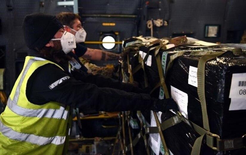Contractors secure pallets aboard a C-5 Super Galaxy.
