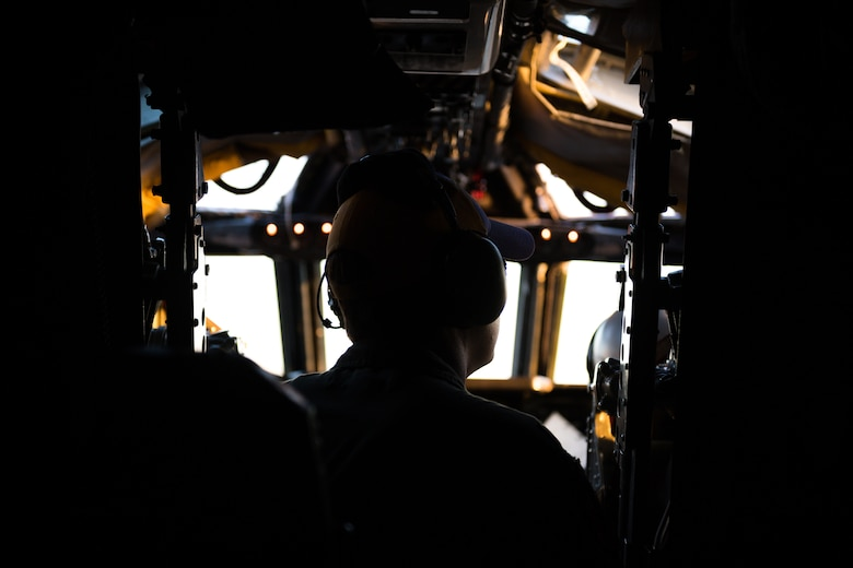 Silhouette of Airman in cockpit of B-52