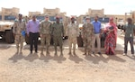 Maj. Jonathan Holliday, Kentucky National Guard Bilateral Affairs Officer (third from left), with U.S. Embassy local staff and Forces Armees Djiboutian (FAD) personnel in Djibouti.
