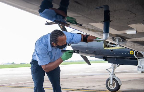 Gaylon Davis, 12th Aircraft Maintenance Squadron, provides routine maintenance by inspecting the wing of a T-6 Texan aircraft at Joint Base San Antonio-Randolph April 7.
