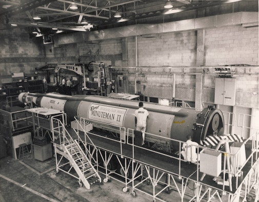 The first advanced Minuteman II missile sitting on a stand at Plant 77.