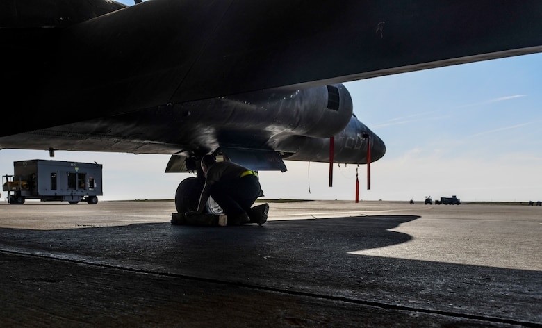 9th Aircraft Maintenance Squadron (AMXS) dedicated crew chief and members tow a U-2 Dragon Lady into a hangar
