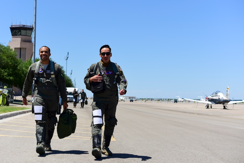 2nd Lt. Roderick Byars, 47 Student Squadron student pilot, and Capt. Joshua White, 434th Flying Training Squadron X flight commander and instructor pilot, walk out on the flightline, April 23, 2020 at Laughlin Air Force Base, Texas, to a T-6A Texan II, the aircraft the 434th FTS trains with. The specialized undergraduate pilot training students still complete the same number of tests, simulations and flights despite COVID-19. (U.S. Air Force photo by Senior Airman Anne McCready)