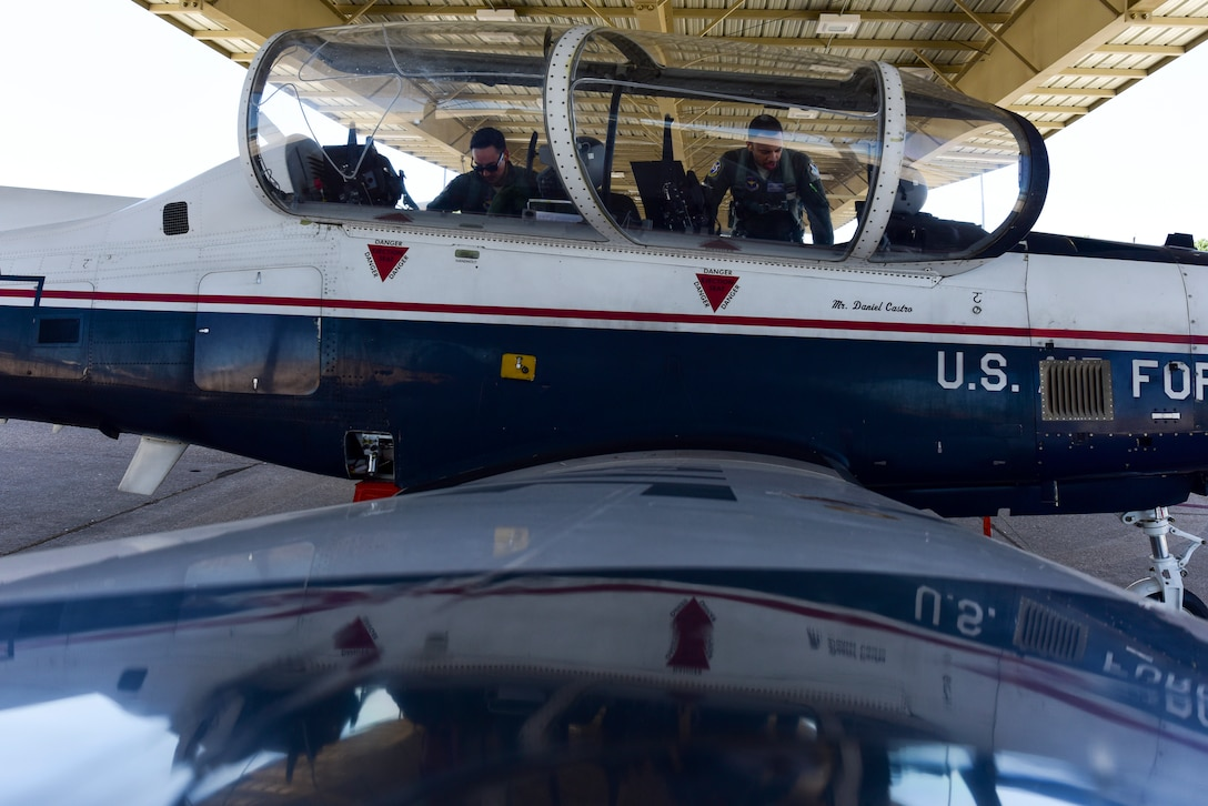 Capt. Joshua White, 434th Flying Training Squadron X flight commander and instructor pilot, and 2nd Lt. Roderick Byars, 47 Student Squadron student pilot, prepare a T-6A Texan II for flight, April 23, 2020 at Laughlin Air Force Base, Texas. The biggest impact White is seeing the Coronavirus take on students and instructors is the ever-changing schedule, which White says they are overcoming by staying flexible. (U.S. Air Force photo by Senior Airman Anne McCready)