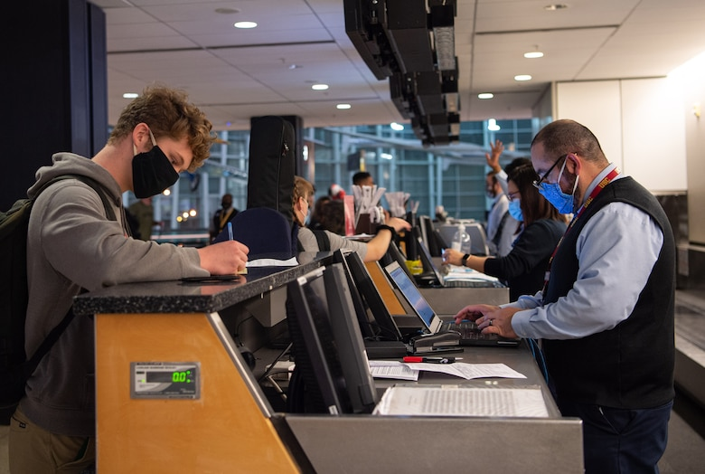 Passengers traveling through the Air Mobility Command terminal check in for their flight at the Seattle-Tacoma International Airport in Seattle, Wash., April 30, 2020. All passengers traveling through the AMC terminal are required to wear facemasks and undergo a medical screening process by the 62nd Aerial Port Squadron to prevent the spread of COVID-19. (U.S. Air Force photo by Senior Airman Tryphena Mayhugh)