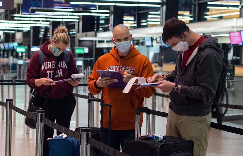Passengers traveling through the Air Mobility Command terminal fill out medical questionnaires at the Seattle-Tacoma International Airport in Seattle, Wash., April 30, 2020. The questionnaires are part of a new screening process implemented by the 62nd Aerial Port Squadron to prevent the spread of COVID-19. (U.S. Air Force photo by Senior Airman Tryphena Mayhugh)