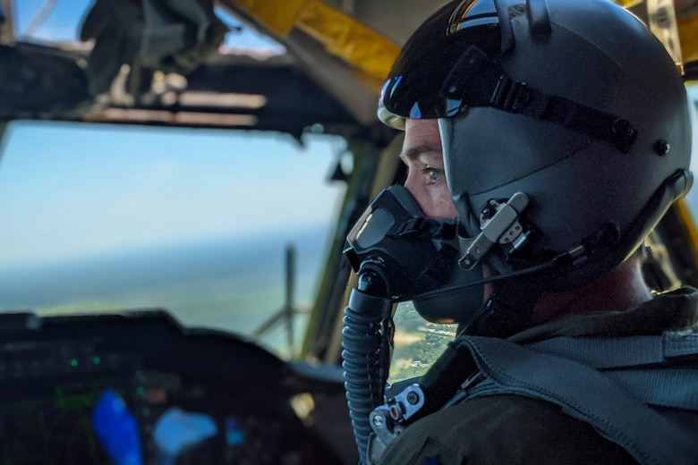 A pilot scans the horizon from a B-52