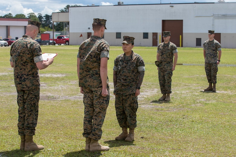 U.S. Marine Corps Sgt. Jennifer Wilbur, receives a Navy and Marine Corps Achievement Medal at Camp Lejeune, N.C., May 1, 2020. Wilbur, a 25 year-old Clearwater, Florida native and chief instructor for the College of Enlisted Military Education Courses, 2nd Maintenance Battalion, was the winner of the second quarter's Commanding General Innovation Challenge for her introduction of Design Thinking into command sponsored primary military education courses. Design Thinking encourages organizations to focus on the people they are creating for, which leads to better products, services, and internal processes. (U.S. Marine Corps photo by Lance Cpl. Scott Jenkins)