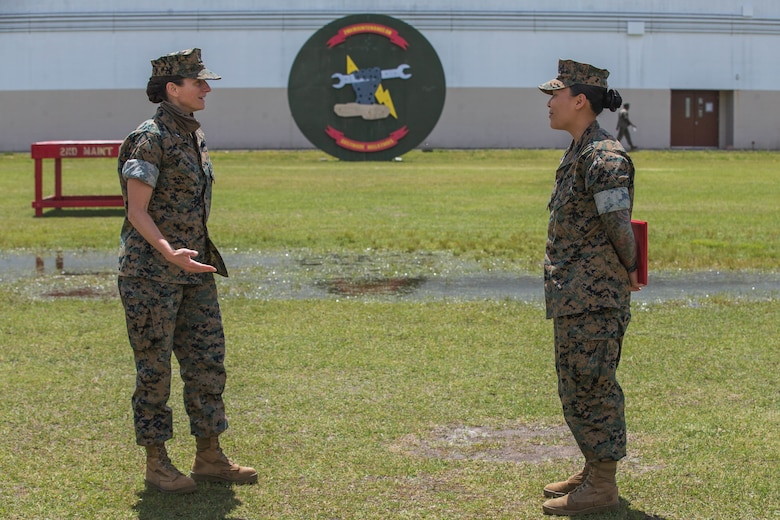 U.S. Marine Corps Lt. Col. Kate Murray, left, battalion commander of 2nd Maintenance Battalion, speaks with Sgt. Jennifer Wilbur at Camp Lejeune, N.C., May 1, 2020. Wilbur, a 25 year-old Clearwater, Florida native and chief instructor for the College of Military Education Courses, 2nd Maintenance Battalion, was the winner of the second quarter's Commanding General Innovation Challenge for her introduction of Design Thinking into command sponsored primary military education courses. Design Thinking encourages organizations to focus on the people they are creating for, which leads to better products, services, and internal processes. (U.S. Marine Corps photo by Lance Cpl. Scott Jenkins)
