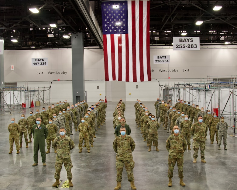 Joint Task Force Aid staff members pose for a group photo at alternate care facility Miami Beach Convention Center. The FLNG has responded to the COVID-19 effort and continues to support the mission. (US Army photo by Sgt. Leia Tascarini)