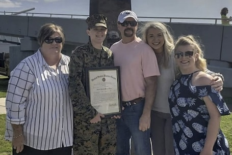 Staff Sgt. Kirk poses for a photo with her family after her promotion to Staff Sgt. aboard the USS Alabama in Mobile, AL. The USS Alabama saw service across the globe during World War II and has been preserved as a museum ship in Mobile Bay, AL since 1964.