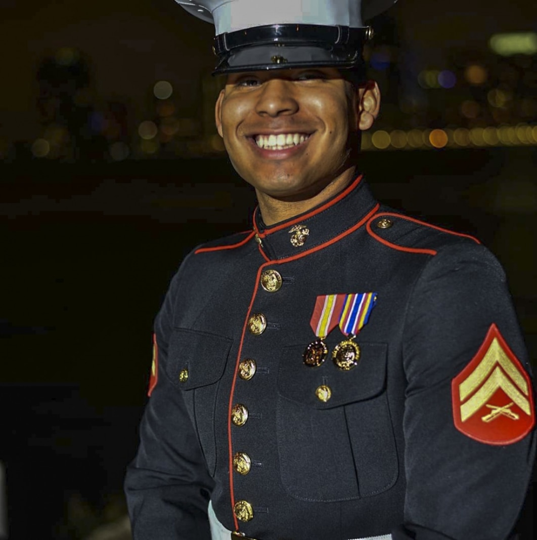 Cpl. Christian Lozano poses for a photo in his dress blue uniform. The dress blues are one of the most iconic uniforms that Marines wear.