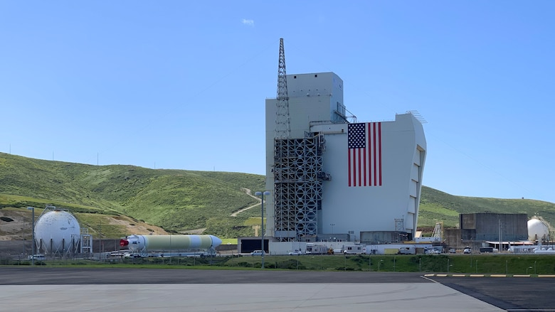 A Delta IV Heavy booster from a United Launch Alliance barge, known as the RocketShip, proceeds to the Horizontal Integration Facility May 4, 2020, at Vandenberg Air Force Base, Calif. A HIF is a building within which the stages of a multistage rocket are brought together before the assembled stack is rolled out to the launch pad or space launch complex and raised into a vertical position for final integration and launch. (Courtesy photo)