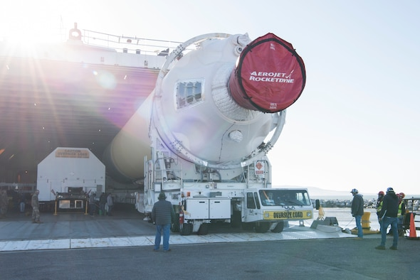 The hatch opens on a United Launch Alliance barge, known as the RocketShip, revealing a Delta IV Heavy booster May 4, 2020, at Vandenberg Air Force Base, Calif. The barge docked at Vandenberg AFB to offload the final Delta IV Heavy booster for an upcoming launch scheduled to occur later this year. The barge operation is a vital first step to executing the mission of assured access to space. (U.S. Air Force photo by Senior Airman Aubree Owens)