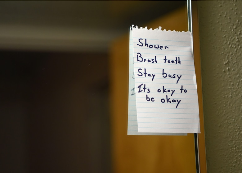 A note containing an Airman's daily schedule is taped to the mirror on Goodfellow Air Force Base, Texas, April 28, 2020. One way to improve your mental health is to keep a schedule. (U.S. Air Force photo by Airman 1st Class Ethan Sherwood)