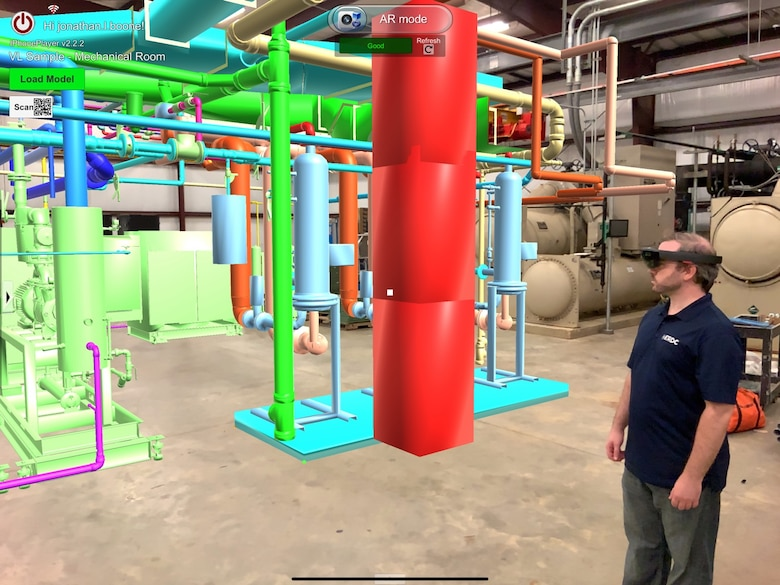 Kelly Irvin of the U.S. Army Engineer Research and Development Center uses augmented reality technology developed in the Information Technology Laboratory to inspect a mock boiler room. The software is being used across the nation to assess potential sites for COVID-19 alternate care facilities, while limiting the number of people who have to physically examine the facilities.