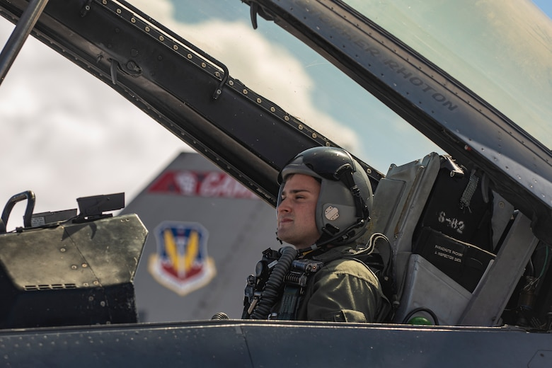 An Airman sits in the cockpit of a F-16.