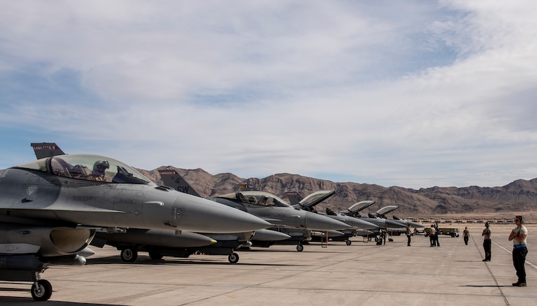 A picture of F-16's and Airmen on the flight line.