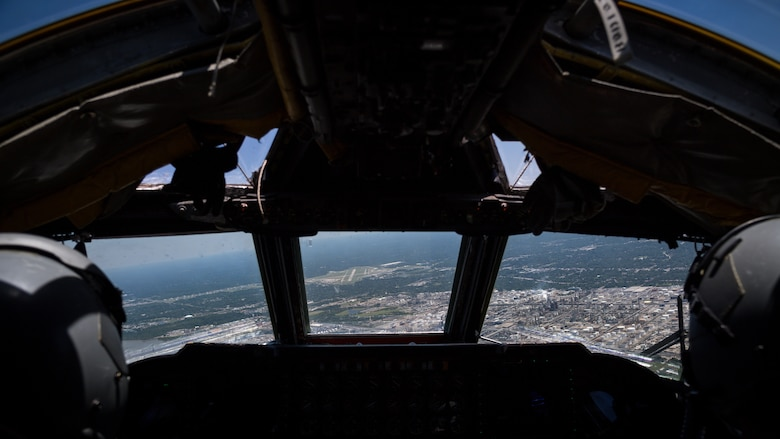 Lt. Col. Michael Green, 343rd Bomb Squadron commander, and Lt. Col. Ryan Decker, 343rd BS director of operations, guide a B-52 Stratofortress over the Louisiana state capitol building in Baton Rouge, May 1, 2020.